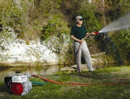 полив огорода с помощью мотопомпы